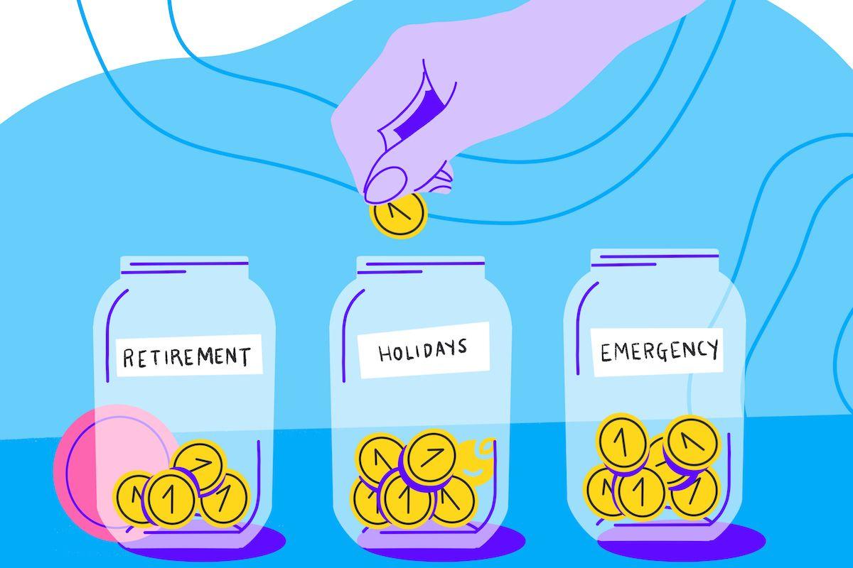 a female hand deposits loose change savings into a jar